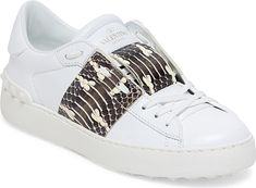 VALENTINO GARAVANI Women's Shoes in Snake Color. Leather low-top sneaker with contrast snakeskin band. Leather and snakeskin upper. Back rubberized pyramid stud trim. Round toe. Slip-on style with lace-up vamp. Leather lining. Rubber sole. Made in Italy. #snake #shoes #fashion #style