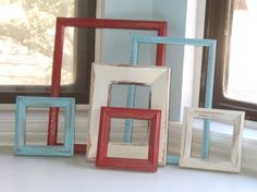 Red, White, and Turqoise Upcycled Frame Collection, by TheArtofChic on etsy.com. These could be hung together on a section of the living room wall without putting any pictures in them.