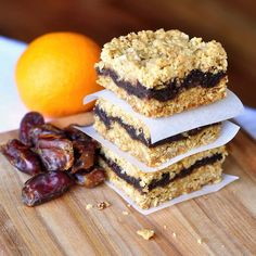 "Orange Date Crumble Bars – a delicious citrus twist on traditional date crumbles or ""Matrimonial Bars"". The buttery oatmeal and coconut crumble is what makes this recipe the best. This recipe is one my mom often Baking Recipes, Cookie Recipes, Dessert Recipes, Olives, Donuts, Newfoundland Recipes, Biscuits, Rock Recipes, Bar Recipes"