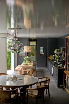 You can do a lot with a small space... High ceilings; big windows framing greenery; sympathetic colors and materials ...
