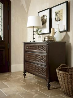 Bring a sense of texture and dimension to your home with this beautiful Hall Chest. The piece features turret corners and a stylish two-tone wood diamond grid pattern across its three drawers. Turned feet complement the shaped corners, giving the piece a traditional silhouette.
