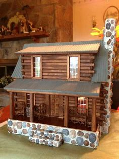 Mountain Cabin customized by Connie Adams Campbell.  This is the 1/2 inch scale Adirondack Cabin Dollhouse Kit by Real Good Toys.