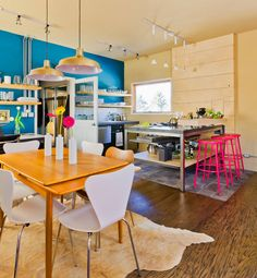 blue feature wall, open shelving and neon pink bar stools