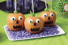 Transform apples into spooky jack-o-lanterns using Candy Melts candy and Halloween Decorating Kit at @partycity!