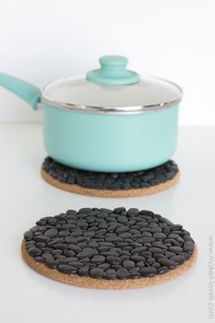 DIY Black Pebble Trivets...a great and inexpensive gift idea!   via Make It and Love It