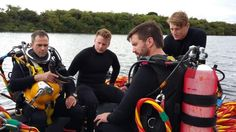 A team of Royal Navy mine clearance divers complete a challenge to walk a marathon underwater to raise money for charity.