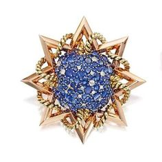 163. TWO-COLOR GOLD, SAPPHIRE AND DIAMOND BROOCH, PAUL FLATO