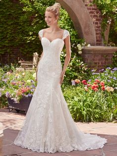 Rebecca Ingram - BRENDA, Layers of tulle and floral lace appliqués evoke antique romance in this fit-and-flare wedding gown, featuring a sweetheart neckline and scalloped hem. Finished with corset closure. Detachable lace cap-sleeves sold separately.