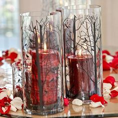 Red candles in rustic holders signify a Snow White wedding theme. #SnowWhite #FairyTaleWeddings