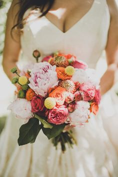 """Pink Peonies, Pink, Coral Orange Roses, Yellow Craspedia, Green Button Mums, Several Other Coordinating """"Tropical"""" Florals & Green """"Tropical"""" Foliage"""
