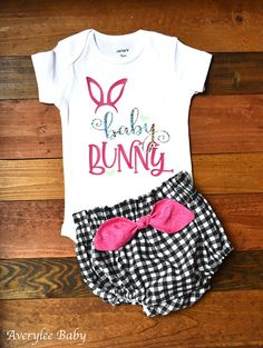 Baby girl Easter bunny bodysuit. Is this your baby girls first Easter? If so, this is an adorable onesie to show off her hoppy self. Created with a silver hologram, sparkle green, and a bright pink, we are confident you will find this bodysuit to be a great addition to her holiday