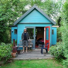 by anja mulder on flickr - coolest hunting (!) shed ever in bright blue with a red door