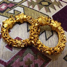 This pair of Amrapali bangles in 22k gold feature double lion heads in mid-roar.  #lovegold