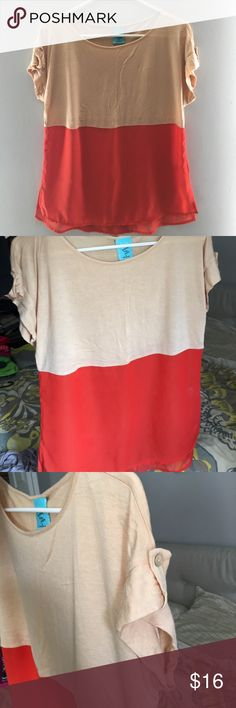 Cute top! Barely worn short sleeved top! Top is tan bottom is pretty shade of orange. Bottom is shear due to chiffon type material-see pic. Sleeve folded with button detail. Back hem is tapered slightly longer than front-prob 1-1.5 inch longer than front. Great shirt only worn once! happening in the present Tops Tees - Short Sleeve