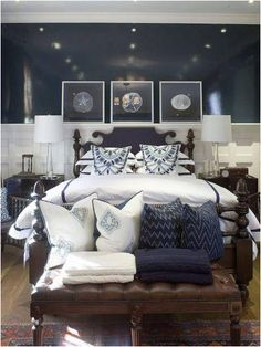 Perfect furniture and accessories for the Navy Room (white sheets, navy and white pillows, dark leather and wood furniture, glass lights, and silver accents
