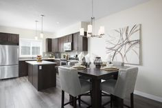 Open main floor layout with the kitchen open to the central dining room Room Kitchen, Dining Room, Floor Layout, Home Builders, New Homes, Flooring, Street, Table, Furniture