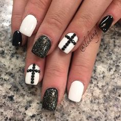 White nails decorated by black beaded cross