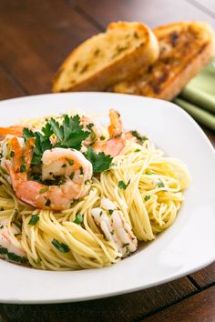 This angel hair with lemon shrimp scampi makes for a super easy family meal, but it's fancy enough for a nice dinner party. Serve with toast