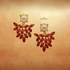 Beautiful red stones paired with a gorgeous pearl in this set of earrings will give your outfit a completely different look. By Atelier Mon, available at Minerali. #minerali_store #beautiful #red #gold #earrings #pearls #ateliermon #designerjewellery #linkingroad #bandra #minerali
