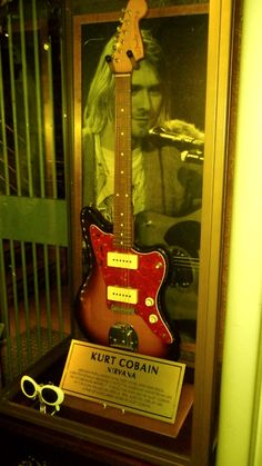 kurt's guitar and sunglasses. May he  R.I.P I miss the amazing rock legend