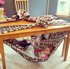 Chair for toddler. Super fun fort idea for kids. Under table swing for toddler. Reading nook for toddler. Cute, easy and free! Simply secure a blanket to your dining table and climb in! Kids Crafts, Projects For Kids, Diy For Kids, Cool Kids, Diy Projects, Indoor Activities, Toddler Activities, Toddler Fun, Toddler Toys