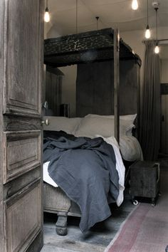 Industrial interior. Wood. Sexy and sensual. Rustic. Elegant.  Chic Bedroom. Love the rich deep colors in contrast to the white sheets. linen, dark blue and gray