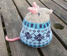 Harold is a tubby little mouse with a smart fair isle jumper. Knitted with a small amount of shetland yarn in 5 colours he is made in two pieces (base and upper) and then seamed, but is easily converted into a seamless knit - you'll just need to sew on the ears and tail. Fill him with beans for added gravitas and he'll make a lovely door stop. Written instructions with a chart for the colourwork.
