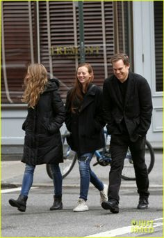 Michael C. Hall and his girlfriend Morgan Macgregor are joined by a pal for a stroll in New York