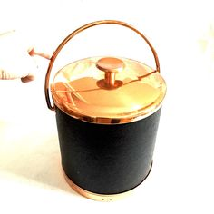 A personal favorite from my Etsy shop https://www.etsy.com/ca/listing/257869138/copper-leather-vintage-ice-bucket