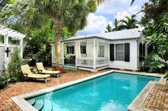 Key West Rentals - 3BR 3BA - Sleeps 8 Just Off Upper Duval Street Private Adjoining Cottages with 2 Private Pools This one-of-a-kind island villa perfectly blends two charming historic cottages right into a little bit of Old Town Key West island heaven. Your own private tropical resort is the feeling you get when you enter the bricked courtyard.