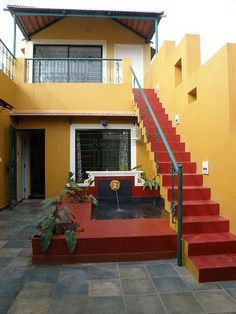 A staircase in the verandah leading up to the second floor. Love the colors. House Roof Design, Village House Design, Small House Design, Indian Interior Design, Indian Home Design, Indian Homes, Home Design Plans, Simple House, House Rooms