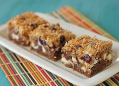 Coconut Ginger Seven Layer Bars - 1 14-ounce can coconut milk 2/3 cup packed brown sugar 4 ounces (8 tablespoons, or 1 stick) unsalted butter 2 cups (9 ounces) crushed ginger cookies like gingersnaps 1/4 cup candied ginger 2 cups toasted pecans 1 cup dried cranberries 1.5 cups chocolate chips 1.5 cups white chocolate chips 1.5 cups shredded coconut