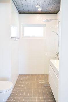 Bathroom with dark wooden ceiling and white tiles. Scandinavian look, interior design: luovisio.fi