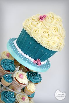Wedding Giant Cupcake- I like the layout and idea of having some mini cupcakes and some normal size Cupcake Table, Big Cupcake, Small Cupcakes, Blue Cupcakes, Cupcake Heaven, Flower Cupcakes, Cupcake Bouquets, Giant Cake, Giant Cupcake Cakes