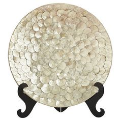 Add visual interest to a table or bookshelf with this oversized, exotic ivory platter, covered with shimmering capiz shells and resting on a lacquered…