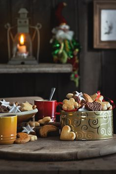 star, moon, and heart shaped tins of cookies + hot cocoa and hot tea