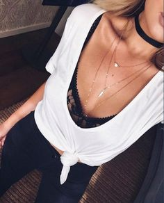 Update a simple monochrome outfit with some necklace layering