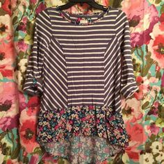 Anthro Postmark Top Blue/purple/grey & white stripped shirt with floral. Postmark brand from Anthropologie. Can be worn as long sleeves or rolled up and buttoned to 3/4 sleeves. Has 2 little pockets in front (see pic). Longer in back, great with leggings! 100% cotton. Perfect condition! Anthropologie Tops
