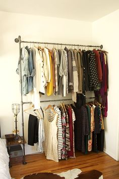 """diy pipe clothing rack @ Home Design Ideas. Something like this might work in the dormers in our bedroom. Then we'd have more """"closet"""" space. Closet Bedroom, Closet Space, Bedroom Decor, Closet Redo, Bedroom Colors, Bedroom Furniture, Makeshift Closet, Diy Clothes Rack, Clothing Racks"""