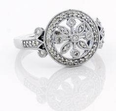 This diamond snowflake ring is featured in 14K white gold but it is also available in 14K yellow gold or 14K rose gold
