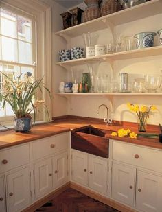Wooden Belfast sink in fitted unit