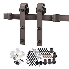 The Bent Strap Barn Door system features a classic face mount flat strap to hang wood doors on a traditional rail track. The large wheels provide excellent strength and durability as-well-as smoothness of travel along the track. Bronze from Home Depot $136