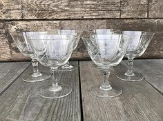 This set of six vintage glasses is so versatile. They would make lovely cordial or sherry glasses, perfect for your favorite dessert wine or champagne. They would be equally nice for sorbet or sherbet. They are made of thin glass that is delicately etched with dots and lines. Measurements: 4 1/8 tall with a 3 7/16 opening diameter Condition: Very good, vintage condition with no chips. SHIPPING TO U.S. & CANADA: We will be happy to combine shipping on multiple items when ava...