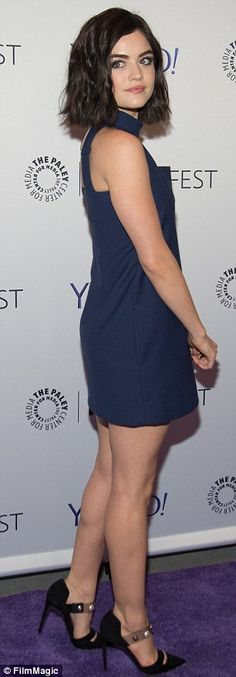 Blue belle: Lucy left her slender legs on show in a skimpy navy mini-dress, paired with black pumps