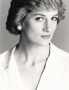 This looks like another 1988 - Princess Diana - portrait by Terence Donovan. Wearing a white suit, and pearl and gold stud earrings. He took a number of pics at different angles/further away from the camera lens.