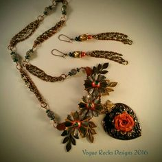 Mixed Metal Mania Challenge 2016 All components from Bsue Boutique except for lovely rose which was created by Paula Gaskill. The heart is  Rusty Black, buffed back to show beautiful copper highlights. Small Brass bee is hanging around the flowers. Brass ox bead and link chain and some copper vintage chain from Bsue Boutique Etsy
