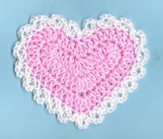 Crochet heart coaster  These are really easy. The edging would be perfect for a baby blanket.