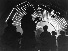Photo of Studio 54 with light display in background. Provenance: Estate of Steve Rubell
