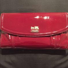 Coach Madison Crimson Patent Wallet This authentic gorgeous wallet is beautiful! It has several slots for all your credit cards and also has a full outer zipper for all your change. ♦️There is a slight separation of the lining on the inner billfold holder, not visible ♦️ This wallet is a perfect addition to any handbag! Coach Bags Wallets