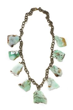 """Look what I found at LizJames.com... Camille - There are many words to describe Camille but invisible is not one of them. This necklace is for someone looking to stand out in a crowd. Large chrysoprase dangle freely from a lovely antique brass chain. 35""""L"""